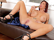 Busty brunette milf pounds her pussy with a glass dildo