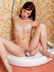 Horny Nubile Leila shoves a dildo deep inside her pussy in the bathroom