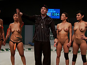 5 girl massive fisting, squirting, fucking, licking orgy from hell. The losers, made to squirt, cum & lick it off the mat all in front of the crowd!
