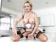 Mature straddles and rides a dildo