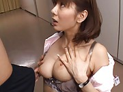 Yuma Asami Asian nurse kneels in front of patient to suck penis