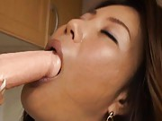 Mio Fujiki Asian rubs pussy with palm in thong and sucks dildo