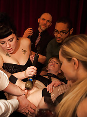 The climax of this dinner: Mallory Malone in a straight jackets being fisted by Aiden Starr and everyone at the party.