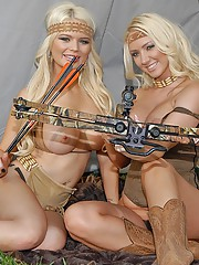 Two hot blond give each other oral in a tent wiht hunting outfits
