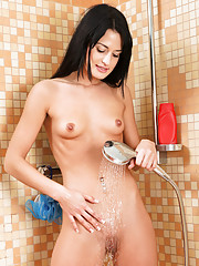Fresh Nubile shows us her smalls tits and wet pussy in the shower