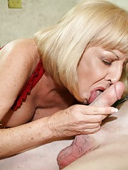 Granny Scarlet and Hottie Wife Tracy suck on a large cock and give the young guy a nice double blowjob
