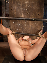 Spread wide open and vulnerable with spreader bars and nipple clamps Matt wastes no time in forcing as many orgasms as he can from her tight cunt.