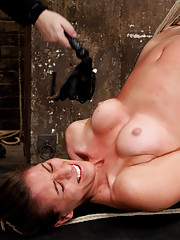 Rilynn is suspended in an incredible back arch position, face fucked, and tormented with hot pleasure and pain play with the vibrator and flogger.