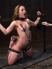 Filthy whore Kristina Rose endures the first part of her Live Show with her arms in metal stocks, vicious nipple clamps, weights, and lots of orgasms.