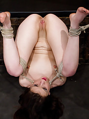 Bound in a pile driver posiiton, Isis Love completely Dominates helpless Juliette with an unforgiving caning, flogging, finger banging, and strap on!