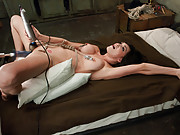 Sexy porn star fucked, nipple clamps rope tied around her body so every jerk of the rope pulls her nipples, machines work her pussy to a creamy mess!