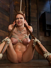 Skinny girl with massive boobs, long legs, suffers a category 5 suspension & skull fucking.  Brutal bondage, devastating orgasms.  Art at it