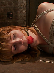 Tall sexy red head with huge nipples, is gagged, bound w/elbows touching, made to cum, hung upside down, whipped, and cropped! heavy pain & pleasure!