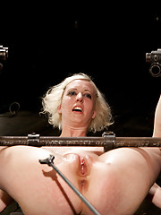 Cherry gets chained up and hoisted in the air, caned, spun around in circles, cattle-prodded, and fucked.