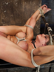 """Sexy blond bomb shell w/huge tits, beautiful face is bound in the ultimate """"fuck me position"""" Anal penetrated, nipple tortured, made to squirt & cum!"""