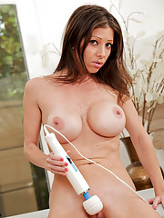 Busty Anilos Angel moistens her magic wand and rubs it on her clitoris