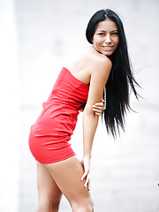 Exotic Nubile in all red luscious dress reveals perky tits and landing strip pussy outdoors