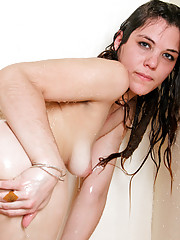 Hot brunette Alice Sweets showers and pleasures her wet hairy pussy
