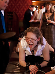 pistol is made to place her head under the table and allow her holes to be violated by tramp before she will be deemed worthy for use by a guest