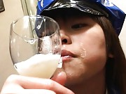 Asuka Sawaguchi with latex police uniform drinking cum from glass