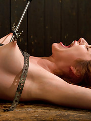 Redhead with silky skin beat with flogger & cane before she is made to cum, ripping brutal orgasms out of her then upside down zipper infused orgasm.