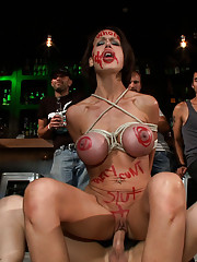 McKenzie Lee is humiliated in a public bar. Tied tight, fucked senseless, and graffitied, she cums uncontrollably and loses all sense of dignity.