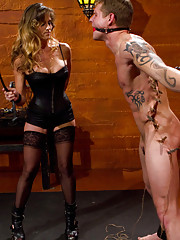 Hot black leather clad dominatrix has dominating sex with muscular slaveboy.