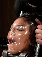 Hottie Adrianna gets her body violated in hard restrictive metal bondage. Her ass is punished with a metal hook and her pussy is fucked and vibed.