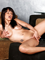 Beautiful babe Jessie Marie spreads her pussy and dips her fingers inside