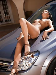 Aiden strips outside and sprawls all over her new ride
