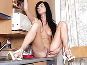 Stunning temptress uses a glass dildo to make her pussy drip