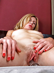 Anilos Mary Jane pummels her wet cougar pussy with a solid glass spiral dildo