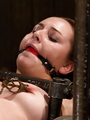 21 year old is made to cum for the second time in her life. Made to squirt. Restrictive metal bondage makes her puffy pussy wet.