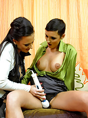 Stroking slippery snatches with a vibrator