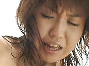 Rino Kamiya Asian is all naked on beach and gets vibrator on cunt