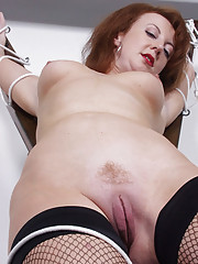 Bondaged fetish mature redhead slut