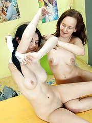 Two horny lesbians enjoy kissing and licking