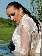 Crazy clothed lady loves swimming in a pond