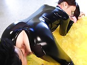 Risa Kasumi Asian has peach licked through latex black costume