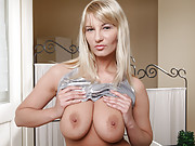 Busty Anilos blonde finger fucks her hairy cougar hole