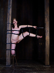 Sarah Shevon gets strapped to a post with her legs spread wide in an excruciating position. Painful nipple clamps, hard flogging, and ass fucking.