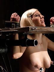 Sexy blond suffers through latex, caning, whipping, fire, orgasms, and nipple torture.