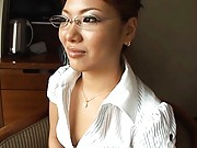 Aya Matsuki Asian looking sexy in office outfit with cleavage