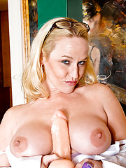 Sweet blonde Anilos fucks a suction cup dildo in stockings and heels