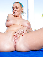 Hot milf of your fantasies fingers her mature pussy by the pool