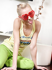 Blond and blue-eyed teen Pinky June in her first photoshoot