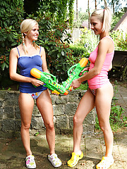 Skinny teen Pinky June plays with water pistols and fucks her gf
