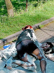 Two fetish girls getting dirty on the street