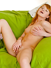 Hot nymph strips and gives her pussy a finger banging on the couch