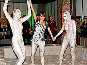 Gorgeous lesbians fighting in a pool of mud